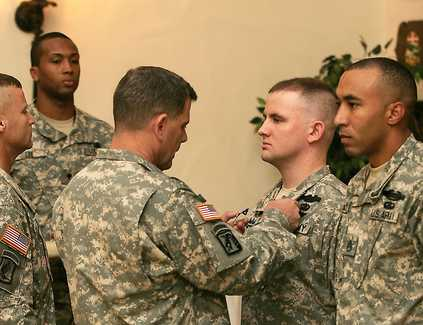 MG Ferriter pins SS on SSG Grimm Dec 09 Wanat