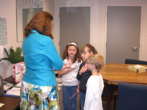 Principal Nancy Rouse and students leading the pledge of Allegiance