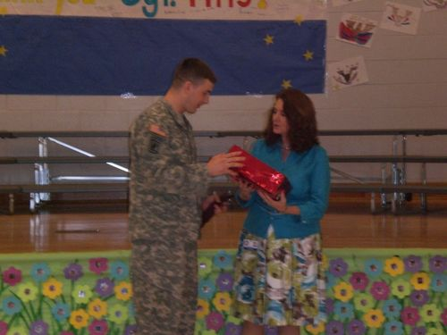 Principal Nancy Rouse giving SSG Pitts letters from the kids