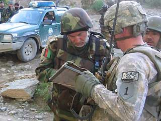 LTC James Markert and Afghan Commander discuss POW recovery operation
