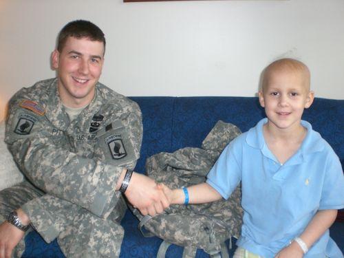 Ryan giving Evan coin from Blackfive